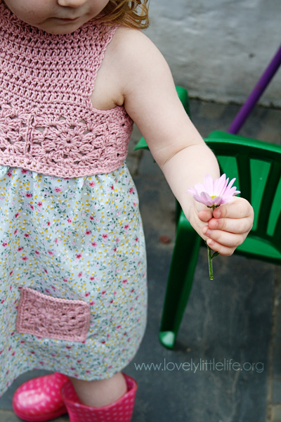 summer dress holding flower