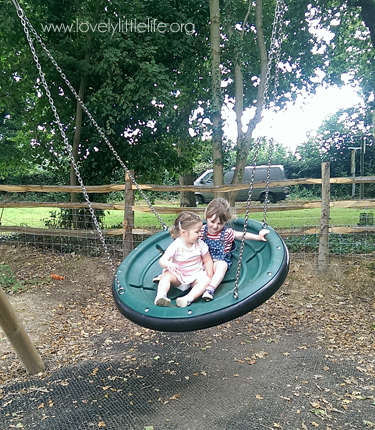 Friends swinging together at the park