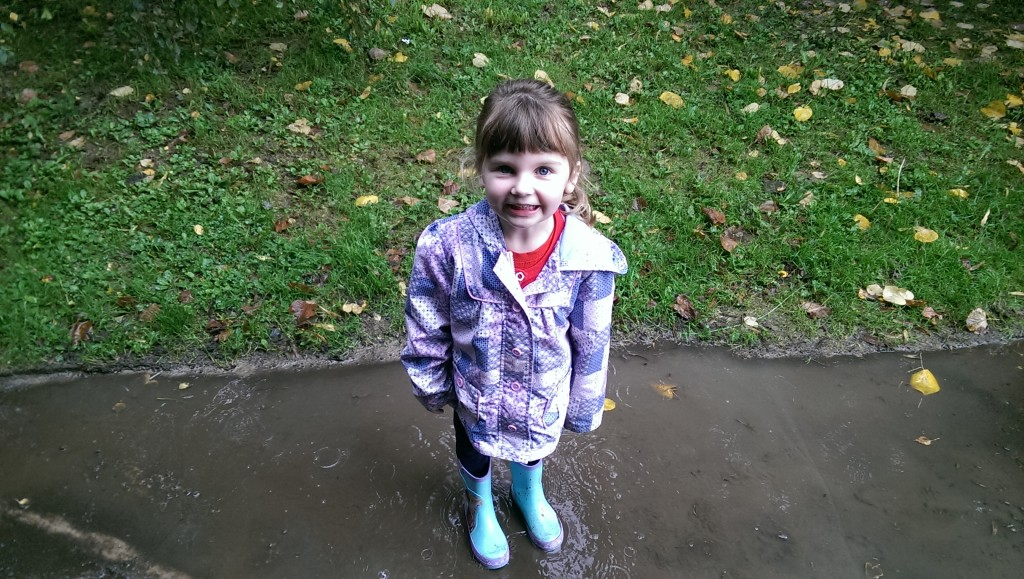 Emma in puddles