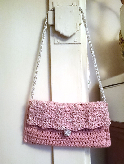Small pink and silver crochet handbag