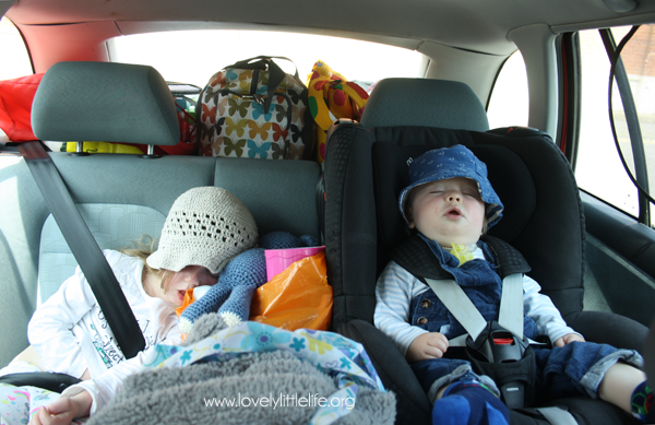 sleeping children in the car home